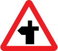 UK Traffic Sign Diagram Number 504.1L - Crossroads Ahead - road continues to left